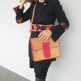 red and natural leather bag